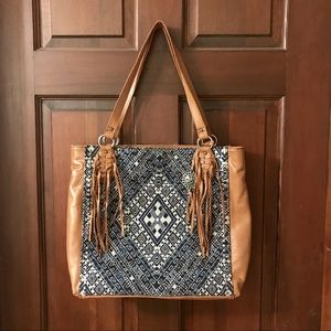 The Sak Leather and Textile Handbag